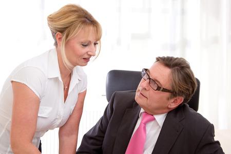 Boss with his secretary. Flirt at Work.