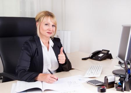 succesful: Succesful businesswoman sitting in her office.