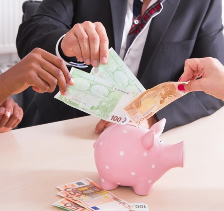 venture: Venture capital - people doing euro in a piggy bank