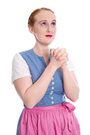 humorously: Bavarian girl praying  Stock Photo