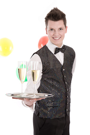 Portrait of a young butler or servant with glasses of champagne - isolated on white photo