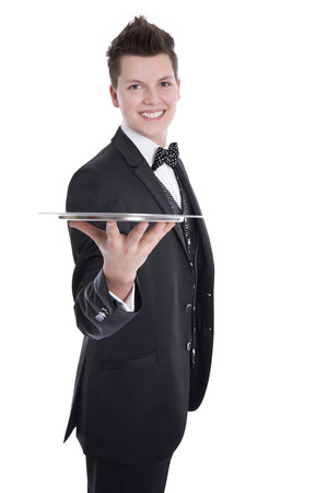 Young butler or waiter in black suit isolated on white background photo