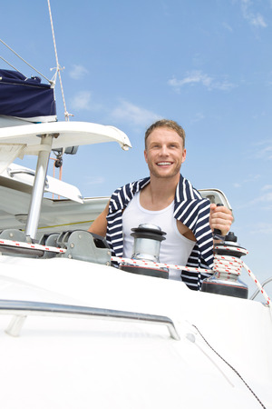 Young man on sailing boat. photo