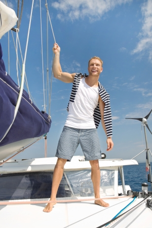 skipper: Young man on sailing boat.