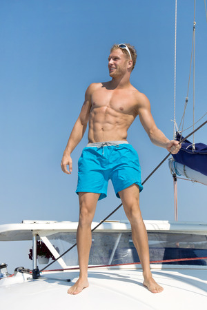 Sexy young man on sailing boat - portrait. photo