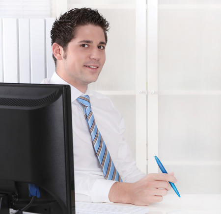 finance director: Smiling manager sitting at office - positive   Stock Photo