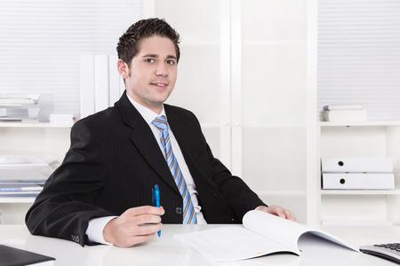 Smiling manager sitting at office