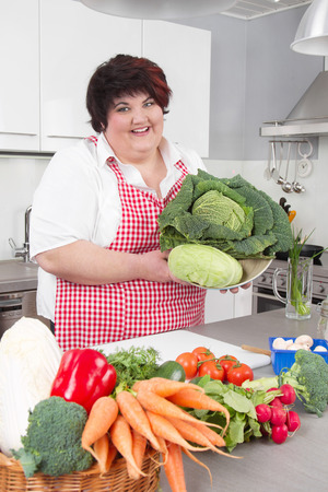 healty: Fad woman is cookind healty food at kitchen.