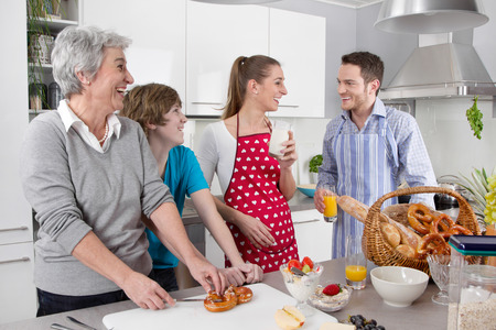 family kitchen: Happy family cooking at kitchen.