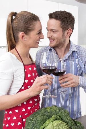 Love couple drinking wine at kitchen.  photo