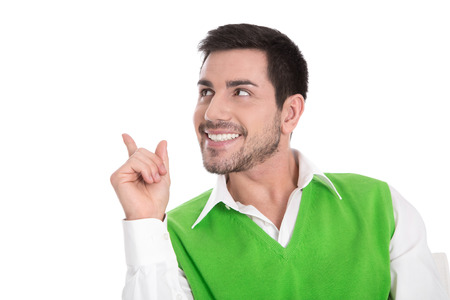 sideways: Isolated business man pointing sneaky, looking away on white background.  Stock Photo