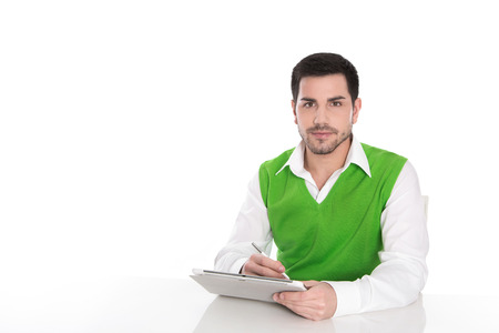 ebusiness: Handsome young business man with his notebook isolated on white.