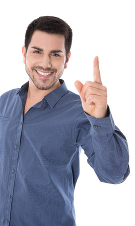 forefinger: Isolated happy man in blue shirt pointing with his forefinger