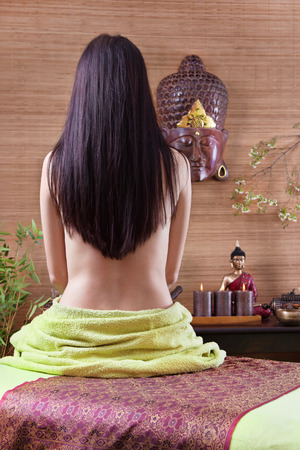 hair back: Woman at spa from the back with long black hair asian style  Stock Photo