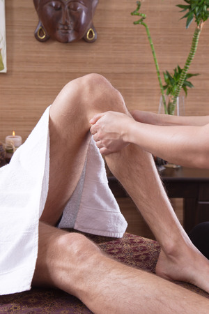 tenseness: Man at traditional thai massage for foots  Stock Photo