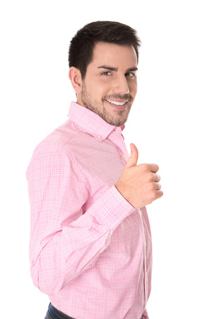 Successful businessman in pink shirt with thumb up   photo