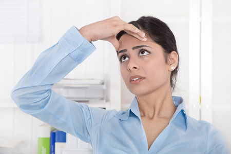 unorganized: Pretty young clerk  has migraine or headache at office. Stock Photo