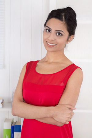 foreign secretary: Attractive young indian woman at office - portrait. Stock Photo