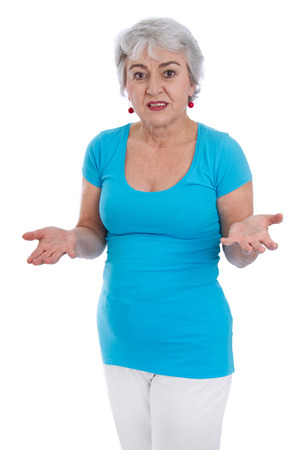 questioning: Sad older woman isolated in a turquoise shirt.