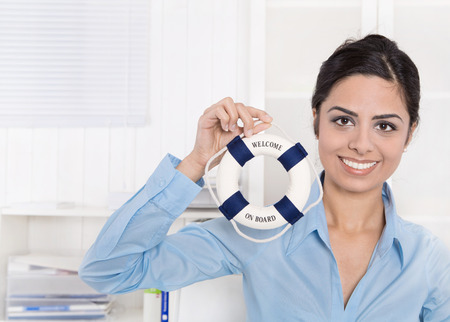 Smiling indian woman holding a lifebelt - concept for teamwork. Stock Photo