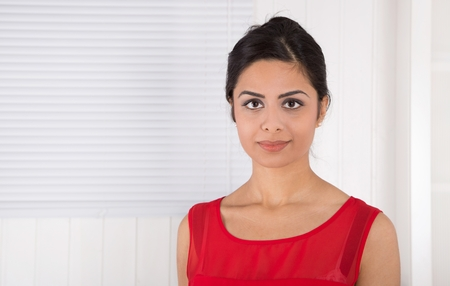 foreign secretary: Beautiful young asian woman in red. Stock Photo
