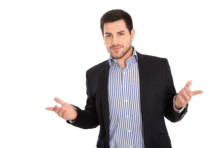 questioning: Portrait of attractive specialist with questioning face and open hands isolated on white. Stock Photo