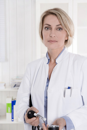 serious doctor: Serious looking female medical doctor in the hospital.