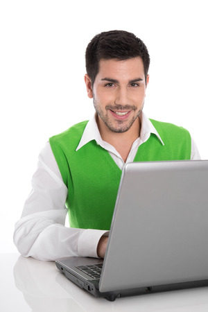 attracive: Isolated attracive businessman working with laptop on white. Stock Photo