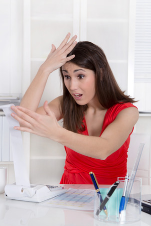 Frustrated businesswoman has computer problems at office. photo