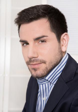Portrait of attractive businessman in blue suit