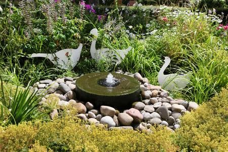 garden fountain: Garden pond - idea for structuring.