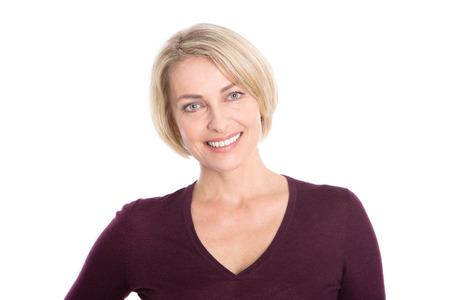 白で隔離金髪のそれ以上の年齢の女性の顔。 写真素材