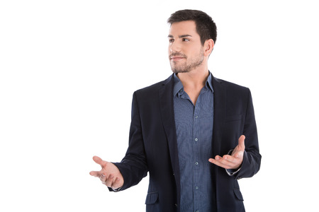 questioning: Isolated questioning young specialist with open hands on white background