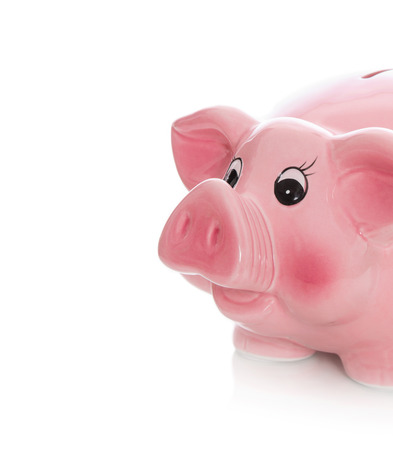 outgoings: Pink piggy bank isolated on white.