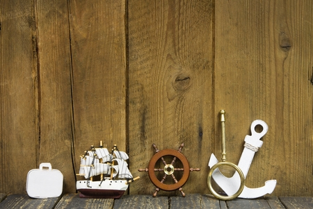 anchor background: On wooden background maritime decoration for cruising trip.