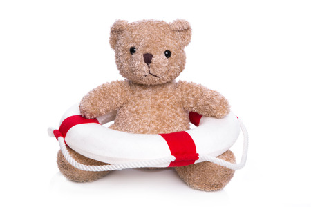 first aid: Concept for children swimming course - isolated brown teddy bear.  Stock Photo