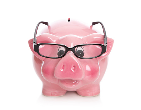 Isolated pink piggy bank with spectacles on white background. photo