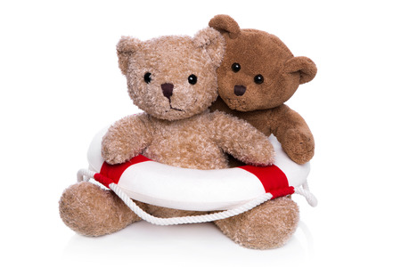 sos: Isolated two brown teddy bears with lifebelt - concept for teamwork.