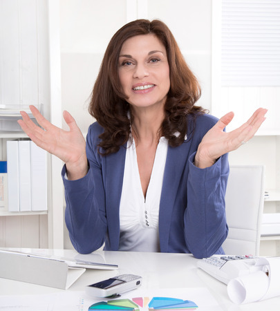 convinced: Convinced and intelligent older business woman talking with hands.