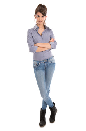 legs folded: Isolated pretty woman in blue jeans and full body length.