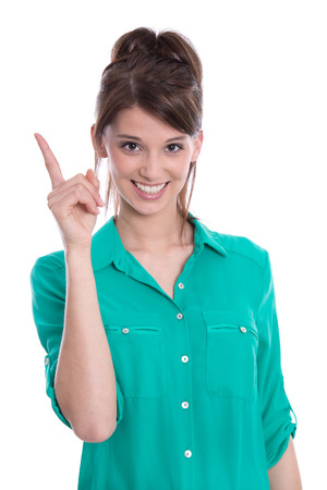woman pointing up: Happy woman in green pointing up with her finger - isolated over white  Stock Photo
