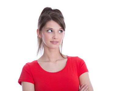 sideways glance: Beautiful young woman in a red shirt looking sideways isolated on white. Stock Photo