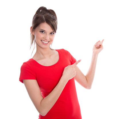 humorously: Happy female teenager in red shirt pointing with her finger