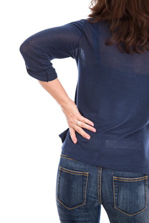 pains: Isolated woman with pains in the back. Stock Photo