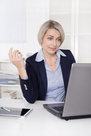 Senior business woman talking with webcam or has data security problems  photo