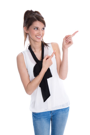 Isolated young smiling trainee is presenting with finger on\ white background