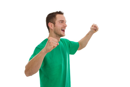 enthusiastic: Enthusiastic young sportsman in green isolated on white.