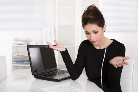 financial controller: Businesswoman shocked about increasing costs or finding an error.