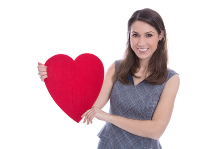 Young smiling woman holding a big red heart in her hands. photo