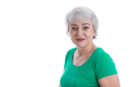 golden ager: Smiling face of a older attractive woman with wrinkles. Stock Photo